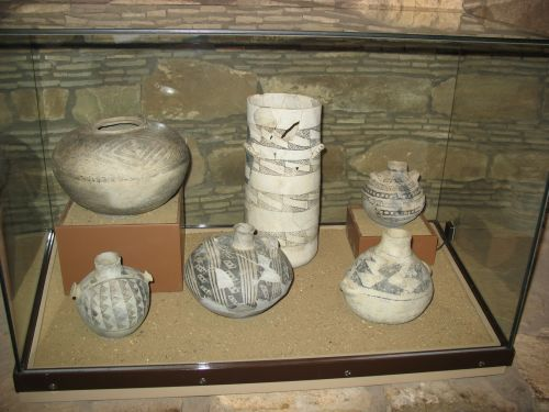 Display Case at Visitor Center Showing Cylinder Jar and Canteens